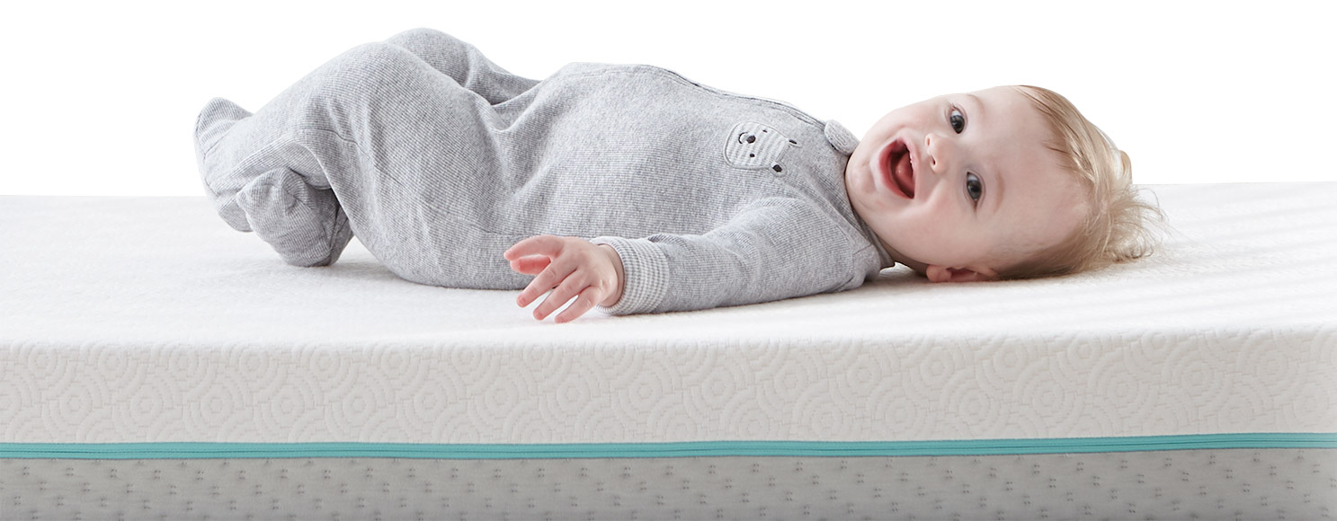 smiling baby on mattress